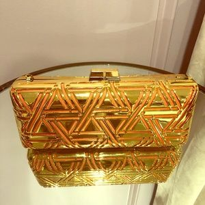 Gold and Orange BCBGMAXAZRIA clutch on chain